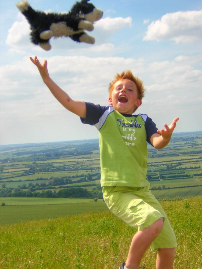 The boy-child, aged 8, playing atop Ivinghoe Beacon, England. Photo: Su Leslie, 2006.