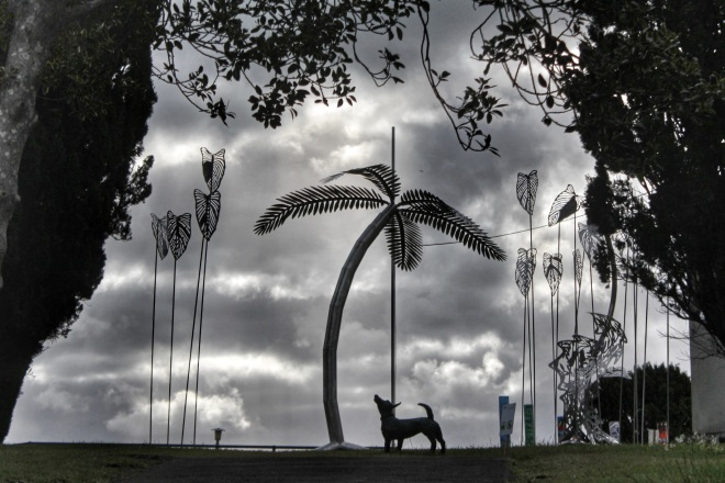 "Trish Clarke's ""Round Up aka Triffid Garden"", and Merle Bishop's ""Spot the Blind Dog"", exhibited at NZ Sculpture OnShore, 2014. Photo: Su Leslie, 2014."