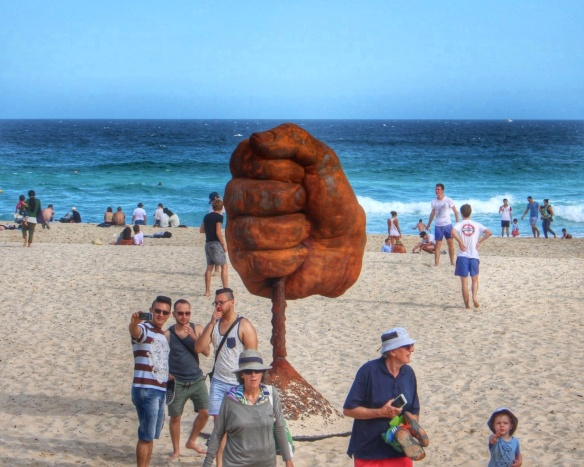 Visitors to Sculpture by the Sea, Bondi, NSW, Australia pose by Norton Flavell's sculpture 'Dust.' Image: Su Leslie, 2015
