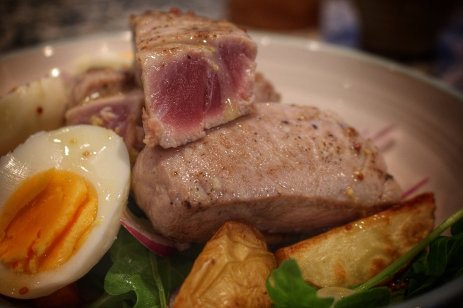 Would the purists admit it as a Salad Nicoise? Seared tuna, boiled egg and saute potatoes. Image: Su Leslie, 2016