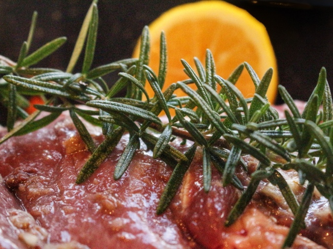 Lamb and rosemary. Lamb leg roasted with anchovy and garlic rub, fresh rosemary and fresh lemon. Image: Su Leslie, 2016