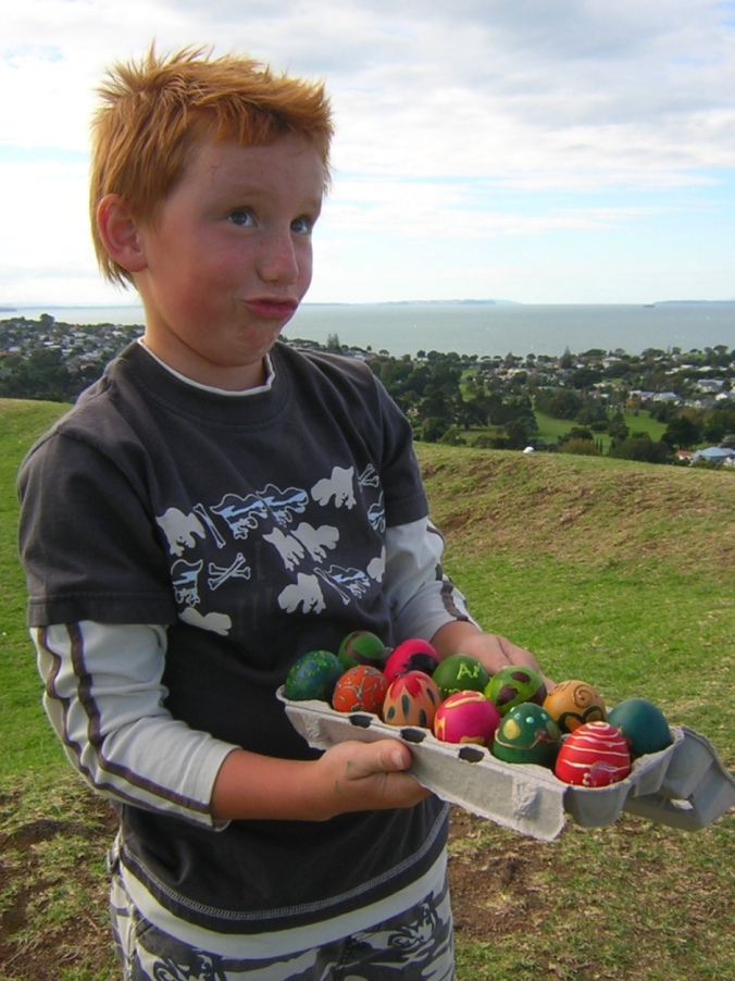 The boy-child with a box of hand-painted eggs, ready for the annual Easter Egg roll on Mt Victoria, Devonport, NZ. Image: Su Leslie