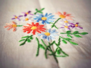 Detail, hand embroidered tablecloth. Image: Su Leslie, 2017