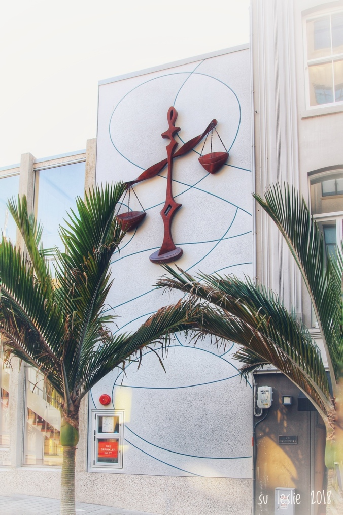 Justice, by Lisa Reihana. Sculpture in bronze on the wall of the O-Connell Street facade of the Ellen Melville Centre, Auckland. Image: Su Leslie, 2018