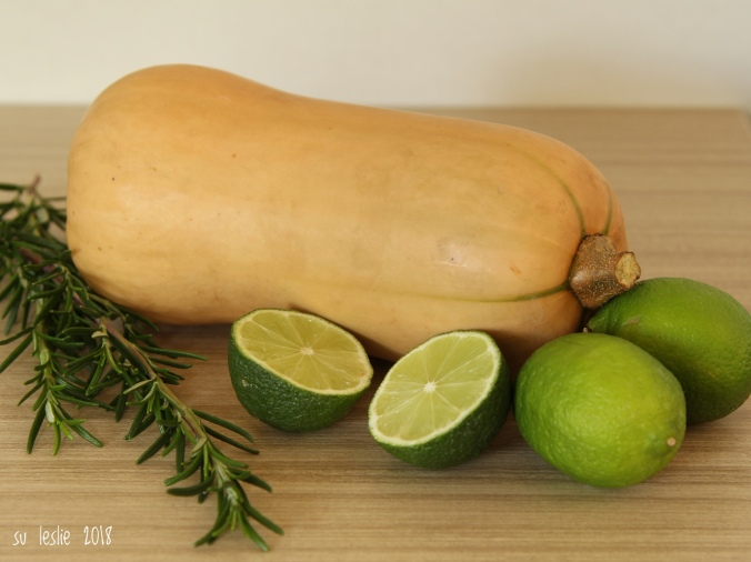 Close up shot of whole butternut squash, whole and halved limes, and rosemary sprigs. Image: Su Leslie, 2018