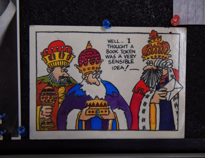 "Shot of greeting card showing the Three Wise Men. Caption says ""well... I thought a book token was a very sensible idea."""