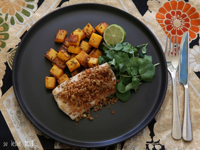 The addition of watercress and a squeeze of lime helped balance the sweetness of the squash.Overhead view of plate with pan-fried tarakihi fillet with rosemary lime crumb, roasted butternut squash and watercress. Su Leslie, 2018