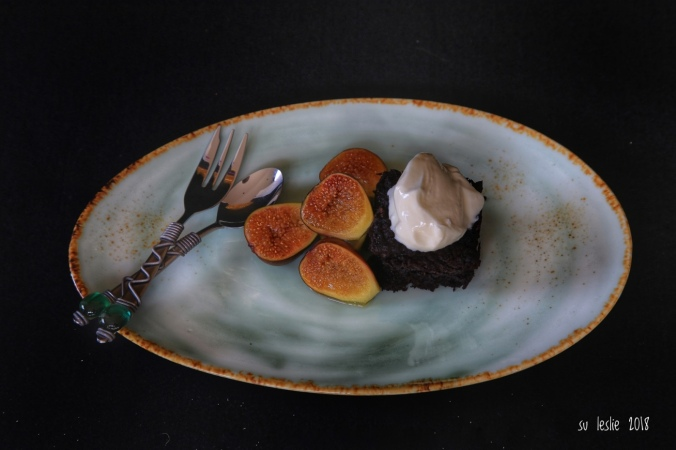 Gluten- and refined sugar-free gooey chocolate brownie with poached figs and yogurt. Image: Su Leslie 2018