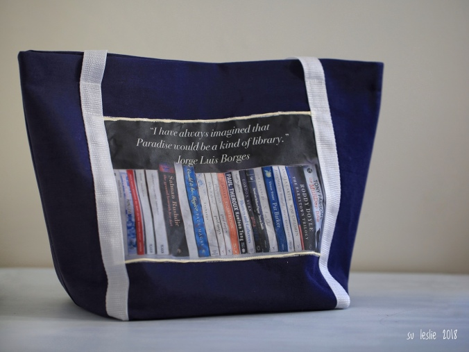 "Blue and white tote bag, for carrying library books. Slogan says ""I have always imagined that Paradise would be a kind of library."" Jorge Luis Borges. Image: Su Leslie, 2018"